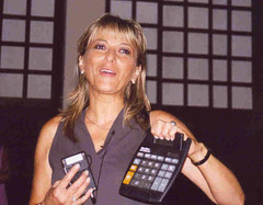 Math for Journalists - Woman holding a calculator